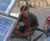 Tony with array at Rancho Solar